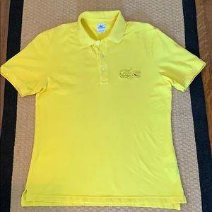 Bright yellow Lacoste polo with oversized logo
